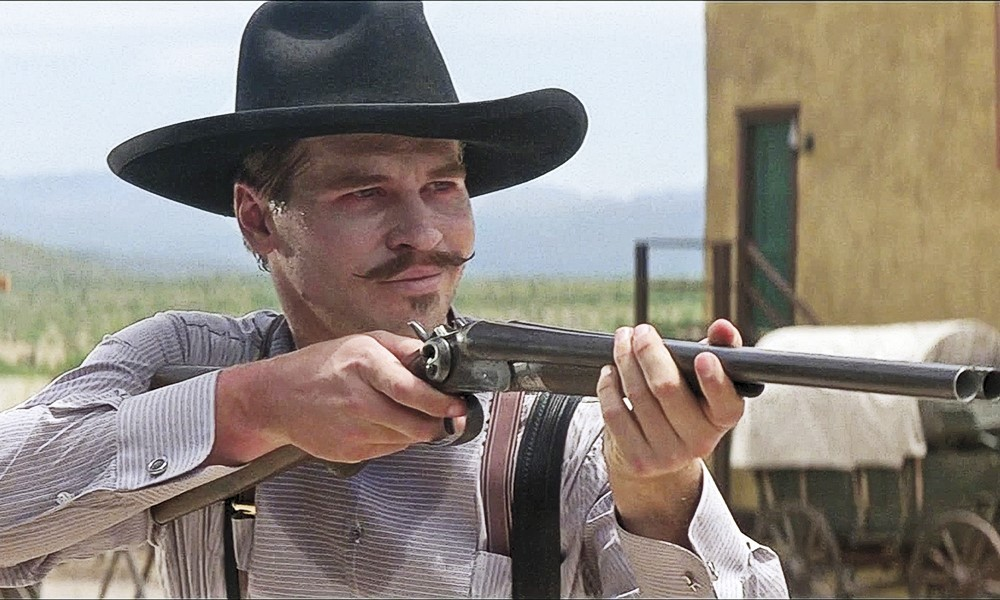 Val Kilmer as Doc Holliday with rifle scaled